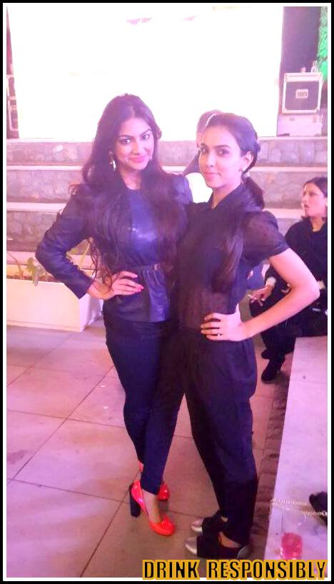 I wore a sheer black shirt with pleated pants and was accompanied by this pretty girl in orange pumps called Kantika Gupta.